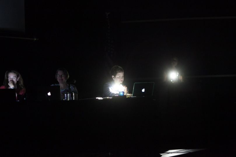 Superintendent Janice Swift is illuminated only by the light of her phone.